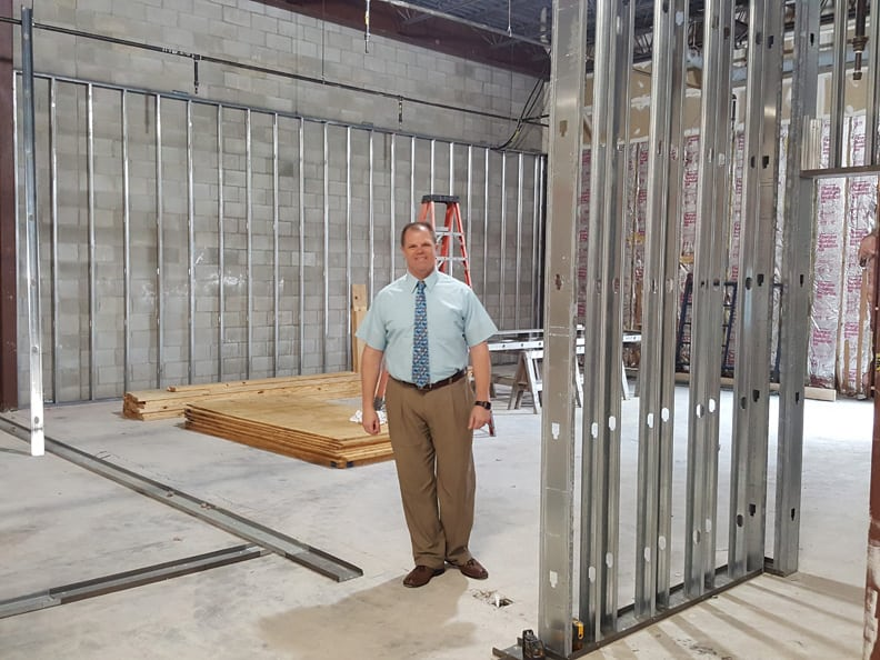 Chris Hemenway stands in the future distribution center of our new headquarters